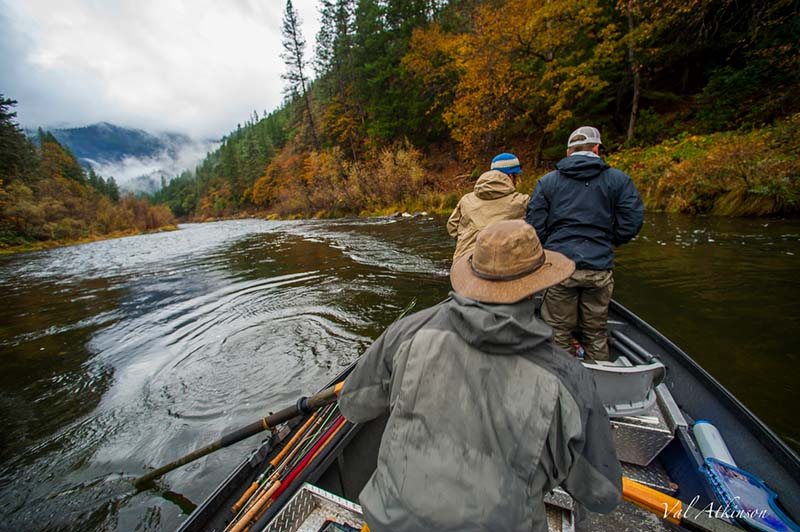 Driftr boat floating down the Klamath River with 3 men on the boat