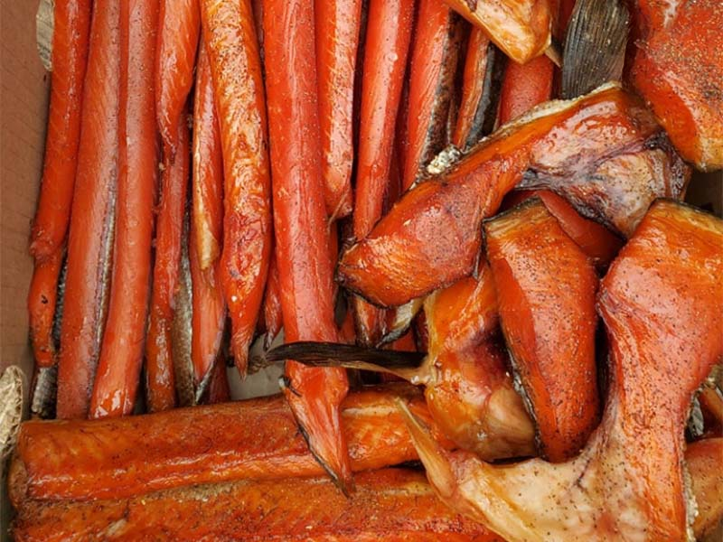 several pieces of smoked salmon in varying sizes and shapes